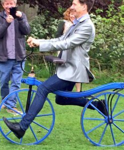 Learning to ride a Regency velocipede at the Fourth Bicentennial John Keats Conference