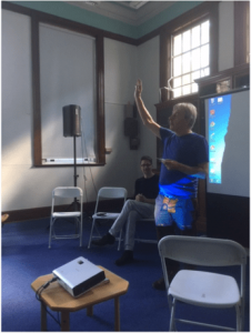 Rico Brown demonstrates Powerpoint at the Keats Conference